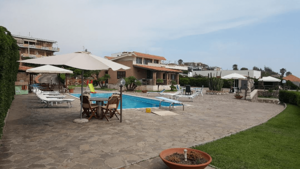 An exclusive villa with a swimming pool at the first beach line
